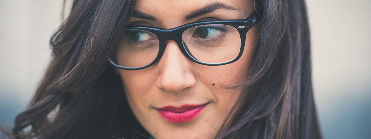 close up woman with eyeglasses